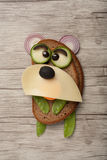 Bear made of bread and cheese. On wooden background Royalty Free Stock Photography