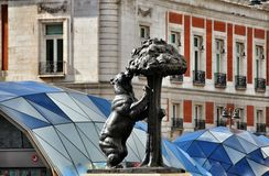 Bear and Madrono Tree. Madrid, Spain Royalty Free Stock Image