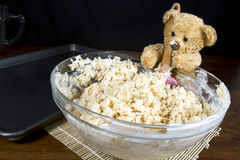 Bear Making Puffed Rice Cereal Treats. Cute teddy bear helper making puffed rice cereal cookie treats stock image