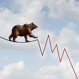 Bear Market Risk. Financial concept as a heavy bearish beast walking on a high tightrope shaped as a stock market loss diagram chart representing the investment Royalty Free Stock Photography
