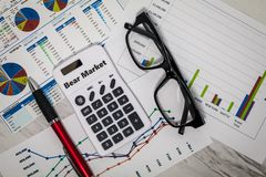 Bear Market still life business finance concept with stock charts. Flat lay royalty free stock photography