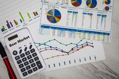 Bear Market still life business finance concept with stock charts. Flat lay royalty free stock image