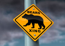 Bear Market Warning sign. With a yellow street icon showing the financial hazards of investing in a tough and bad economy with sellers of stock and unemployment Stock Photography
