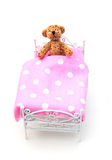 Bear with measles. Teddy Bear in bed covered in measles royalty free stock photography