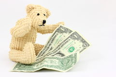 Bear With Money. A small teddy bear with three one dollar bills, ready to help young children learn about their money Royalty Free Stock Photography