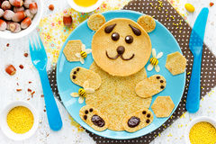 Bear pancakes with honey and nuts for kids breakfast Royalty Free Stock Photography