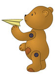 Bear with paper plane. Brown patched teddy-bear standing and holding in a hand paper toy plane r Stock Photos