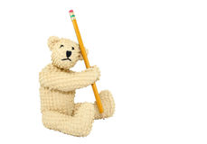 Bear With Pencil. A small teddy bear ready for school with his yellow no. 2 pencil. Bear photographed on a white background Royalty Free Stock Image