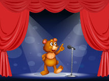 A bear performing on the stage Royalty Free Stock Photo