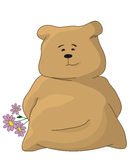 Bear-pillow with a bunch of flowers Stock Photos