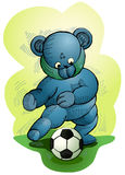Bear playing soccer Royalty Free Stock Photos