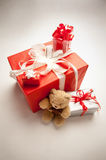 Bear with presents and gifts. Big red present and several smaller gifts in composition Stock Photo