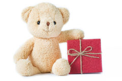 Bear doll with red gift box on white background isolated. Stock Photos