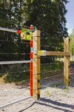 Bear-resistant electric fence and gate. With warning sign around a tenting area in a Yukon park, Canada royalty free stock image
