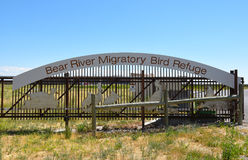 Bear River Migratory Bird Refuge. BRIGHAM CITY, UTAH - JUNE 28, 2017: Bear River Migratory Bird Refuge entrance gate and sign. The refuge covers the Bear River stock images