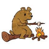 Bear roasting marshmallows. Stock Photography