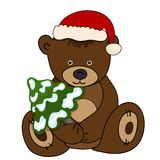 Bear in Santa Claus hat holding a fir tree Royalty Free Stock Photos