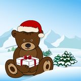 Bear in Santa Claus holding a box present Royalty Free Stock Photography