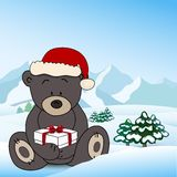 Bear in Santa Claus holding a box present Royalty Free Stock Photos