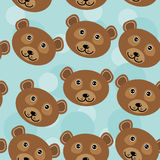 Bear Seamless pattern with funny cute animal face on a blue back Royalty Free Stock Photos
