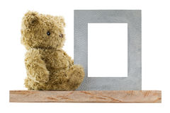 Bear sitting next to blank metal picture frame made of real silv Royalty Free Stock Photography