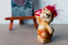 Bear. Small cute ceramic bear with heart Stock Image