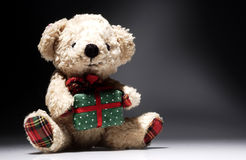 Bear soft toys. With gift on background nuanced stock images