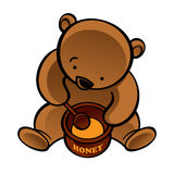 Bear with spoon and honey pot Royalty Free Stock Photos