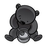 Bear with spoon and honey pot Stock Photo