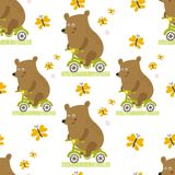 Bear to ride a bike vector seamless pattern. royalty free stock photo