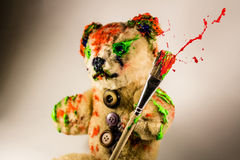 Bear toy as an artist holding a paintbrush Royalty Free Stock Photo