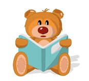 Bear toy with book Royalty Free Stock Images