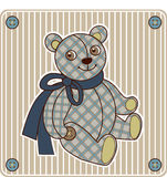 Bear toy. In the box on the striped background Royalty Free Stock Images