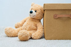 Bear toy and brown textile box with handles and cover Royalty Free Stock Images