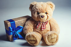 Bear toy with gift box Stock Photos