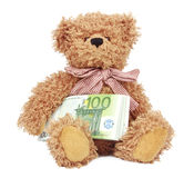 Bear toy with money Royalty Free Stock Photography