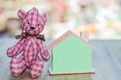 Bear toy save money to buy a house Stock Images