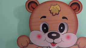 Bear toy wall clock with moving eyes.  stock footage