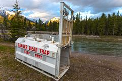 Bear Trap Bow River Canmore Canada Rocky Mountains Banff National Park. Bear Trap Metal Cage by Bow River in Town of Canmore Alberta Canada at Foothills of Rocky Stock Image