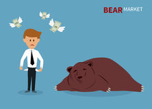 Bear treading on the stock market. Stock Photo