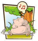 Bear under tree. Bear sits near a tree and sings Stock Image