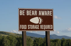 Bear Warning Sign. Brown sign warning of bear safety precautions Royalty Free Stock Image
