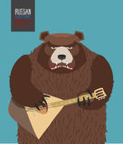 Bear was playing the balalaika. Russian national music Royalty Free Stock Images