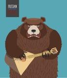 Bear was playing the balalaika. Russian national music. Al instrument Royalty Free Stock Images