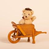 Bear in wheel barrow Royalty Free Stock Photo