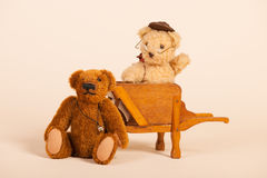 Bear in wheel barrow Royalty Free Stock Images