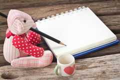 Bear write the book. On garden background Stock Image