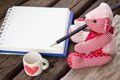Bear write the book. On garden background Royalty Free Stock Photo