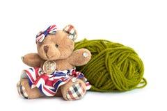 Bear and yarn isolated white background. Bear and green yarn isolated white background stock image