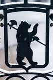 Bear - Yaroslavl arms. Bear with ax - Yaroslavl arms, Russia. Metal forged fence above the river Royalty Free Stock Photo